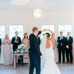 Groom twirls bride during their Dairy Barn reception coordinated by Magnificent Moments Weddings