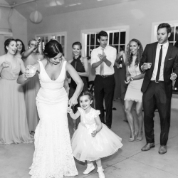 Bride dances with flowergirl to music provided by Split Second Sound at her Diary Barn Wedding
