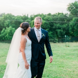 Bride and groom walking outdoors before their wedding captured by Ashley Sue Photography