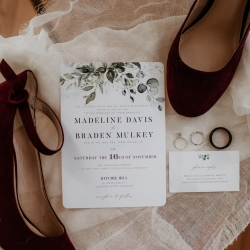 Bridal invitation and shoes are the perfect subject matter for a fall wedding coordinated by Magnificent Moments Weddings