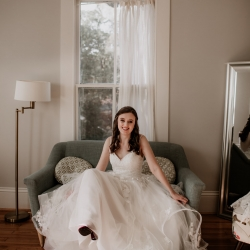 Bride shows off her hair and make up by Megan Oliveri Artistry during her fall wedding