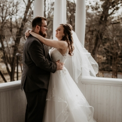 The porch of Ritchie Hill was the perfect setting for a fall bride and groom to be captured by Avonne Photography