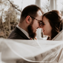 Bride and groom share a sweet moment during their fall wedding captured by Avonne Photography