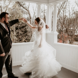 Bride and groom share a sweet moment during their fall wedding coordinated by Magnificent Moments Weddings