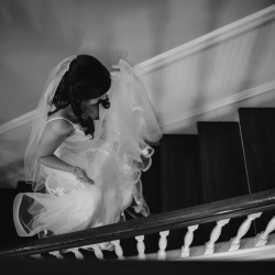 Avonne Photography captures a bride as she prepares to walk down the aisle during her fall wedding at Ritchie Hill