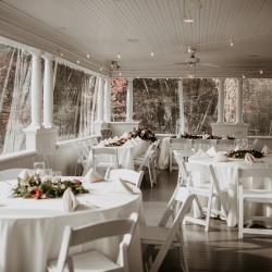 Simple white linens are a classic look for a fall wedding on the porch of Ritchie Hill