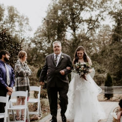 Bride is escorted down the aisle by her father during her fall ceremony at Ritchie Hill