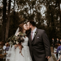 Avonne Photography captures a bride and groom as they share one last kiss following their wedding ceremony at Ritchie HIll
