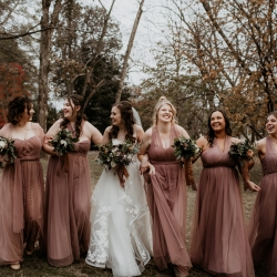 Bride and her bridesmaids pose for Avonne Photography during their fall wedding at Ritchie Hill