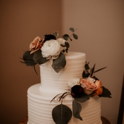 Two tiered cake with lush flowers is the perfect treat created by Suarez Bakery