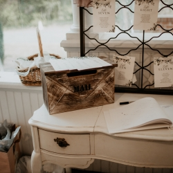 Custom wooden card box and guest book are the perfect places for guests to leave love for a bride and grooms wedding at Ritchie Hill