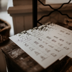 Custom programs show off the order of events for guests at a fall wedding at Ritchie Hill