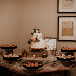Avonne Photography captures the dessert table full of sweet treats from Suarez Baker during a fall wedding at Ritchie Hill