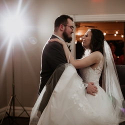 Bride and groom share a sweet first dance to music by Split Second Sound during their fall wedding at Ritchie Hill