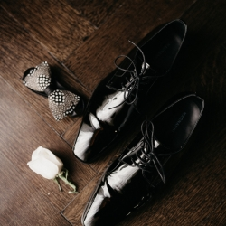 Grooms shoes and tie are the details for a spring wedding planned by Magnificent Moments Weddings
