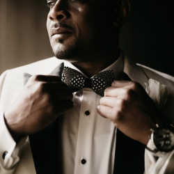 """Groom prepares to say """"I Do"""" by fixing his tie at the Ritz Carlton prior to his wedding ceremony"""