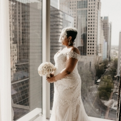 Avonne Photography captures a bride as she prepares for her wedding planned by Magnificent Moments Weddings