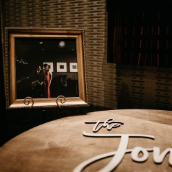 Stunning photography of the bride and groom were placed on tables throughout the cocktail space at The Ritz Carlton