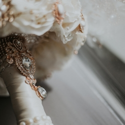Broach detail was an eye catcher for her spring wedding at The Ritz Carlton in uptown Charlotte