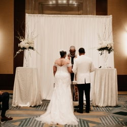 Stunning alter is accented by large white floral arranges made by Party Blooms