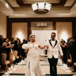 Bride and groom depart their ceremony at The Ritz Carlton after exchanging vows and becoming husband and wife