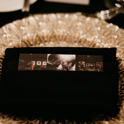 Photo cards added a personal touch to each place setting which was accented with a gold charger from CLux and crisp black napkins