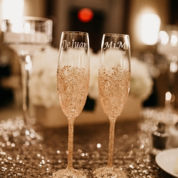 Custom champagne flutes with gold sparkler are the perfect pair for newlyweds at The Ritz Carlton