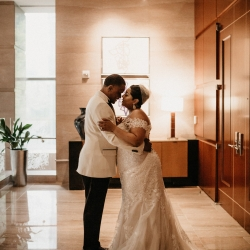 Bride and groom share a sweet moment after exchanging vows all captured by Avonne Photography