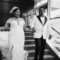 Bride and groom exit their ceremony planned by Magnificent Moments Weddings at The Ritz Carlton