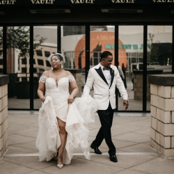 Bride and groom share a smile during their photo shoot in Uptown Charlotte during their spring wedding at The Ritz Carlton