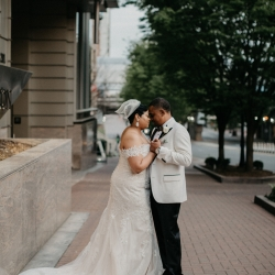Avonne Photography captures a bride and groom on the streets of Uptown Charlotte following with wedding ceremony planned by Magnificent Moments Weddings