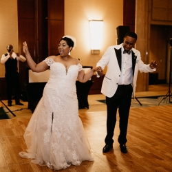 Bride and groom having fun during their spring wedding at the Ritz Carlton being introduced by Ceasefire Productions