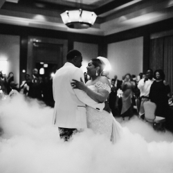 Avonne Photography captures a stunning image of a bride and groom during their first dance almost as if they are dancing on a cloud