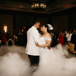 Bride and groom share a first dance in a sea of smoke created by Ceasefire Productions for a spring wedding at The Ritz Carlton