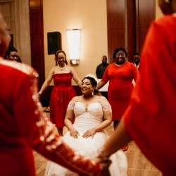 Bride is surrounded by her sorority sisters for a special moment during her spring wedding reception at the Ritz Carlton captured by Avonne Photography
