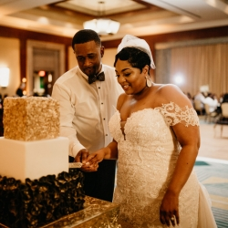 Bride and groom cut a stunning three layer cake made by the Ritz Carlton's bakery team its featured hints of gold and leave details