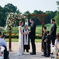 Reverend Rebecca Nagy officiates over a spring wedding at The Ballantyne Hotel