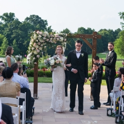 The Bride and groom leave their wedding ceremony coordinated by Magnificent Moments Weddings as husband and wife
