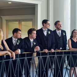 Groomsmen share a calm moment together before the wedding ceremony coordinated by Magnificent Moments Weddings begins