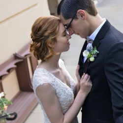 Bride and groom embrace before walking down the aisle to their wedding ceremony at The Ballantyne Hotel