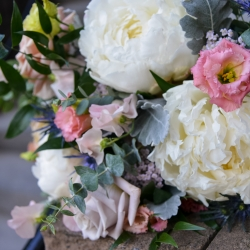 Georgestreet Photography captures the details of a bridal bouquet featuring soft spring colors created by Jimmy Blooms
