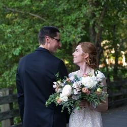 Bride and groom share a sweet glance after their first look at The Ballantyne Hotel