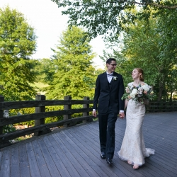 Bride and groom walk hand in hand after their first look coordinated by Magnificent Moments Weddings