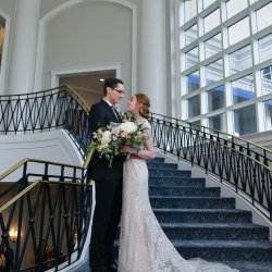Georgestreet photography captures a loving moment between a bride and groom on the staircase of The Ballantyne Hotel