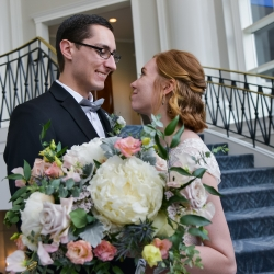 Bride and groom share a sweet look during their spring wedding at The Ballantyne Hotel