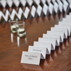 Guests escort cards are placed in a fun pattern for a spring wedding at Ballantyne Hotel