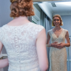 Bride takes a last glance captured by Georgestreet Photography before her wedding at The Ballantyne Hotel