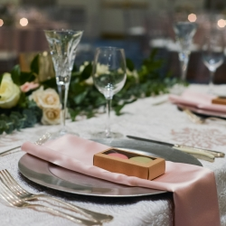 Soft pink names set off a silver charger perfect for a spring wedding coordinated by Magnificent Moments Weddings
