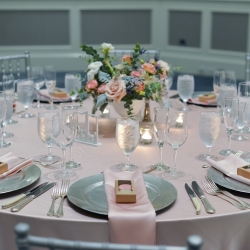Soft pink linens, silver linens, and floral centerpieces from Jimmy Blooms are the perfect accent for a spring wedding at The Ballantyne Hotel