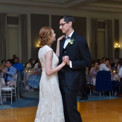 Bride and groom share a first dance during their wedding reception at The Ballantyne Hotel captured by Georgestreet Phtography